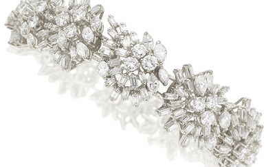 Diamond, White Gold Bracelet The bracelet features marquise, baguette...