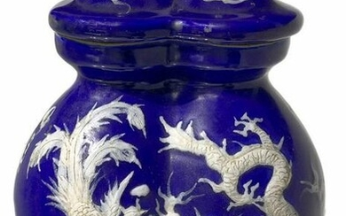 Double blue vase with relief decoration on both sides