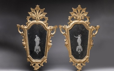 PAIR OF MIRRORS with VENUS and DIANE in an eventful shape, in a gilded wooden Rococo frame with motifs of blooming flowers and interlacing; the mirrors decorated in the centre with Venus for one, Diana for the other in agglomerated glass. Probably...