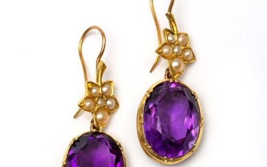 Pair of gold earrings, each with an oval...