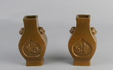 Two Chinese porcelain vases with brown glaze, figures
