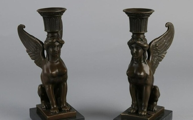 Two bronze Empire style candle holders with caryatids