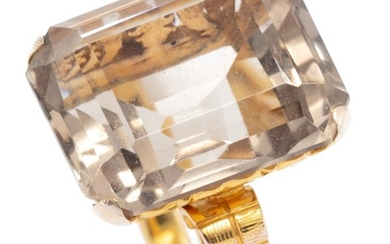 A 14CT GOLD QUARTZ COCKTAIL RING; featuring a step cut smoky quartz of approx. 16.3ct to pierced scrolling gallery and engraved shou...
