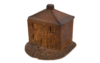 A 19/20TH CENTURY STONEWARE MONEY BOX IN THE FORM OF A COTTAGE