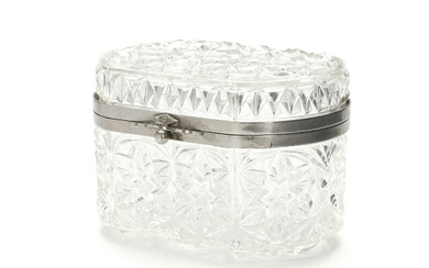 A 20th century clear pressed glass sugar casket with silver plate brass mounting. H. 9. L. 13. W. 9 cm.