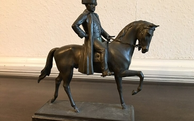 A 20th century patinated metal figure of Napoleon on horseback. Marble base. H. 28 cm.