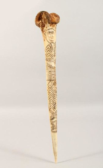 A CARVED BONE DAGGER, with incised decoration.