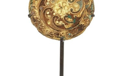 A Chinese bronze and gold circular plaque, Eastern Han dynasty,...