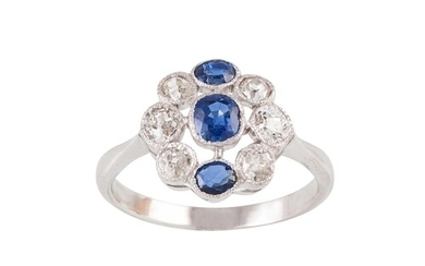 A DIAMOND AND SAPPHIRE CLUSTER RING, set with cushion cut sa...