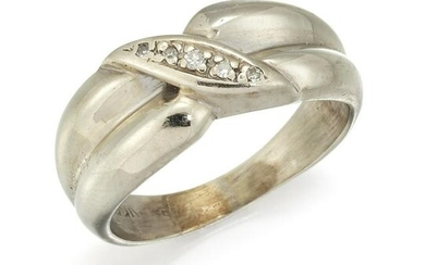 A DIAMOND CROSSOVER RING, the tapered crossover ring