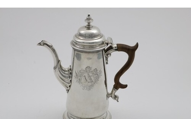 A GEORGE II COFFEE POT of tapering cylindrical form on a lar...