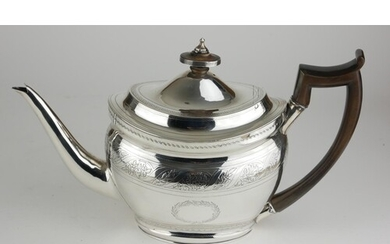 A GEORGE III CLASSICAL FORM SILVER OVAL TEAPOT With carved ...