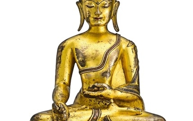 A GILT-BRONZE AND COPPER-INLAID FIGURE OF MEDICINE BUDDHA TIBET, 13TH – 14TH CENTURY