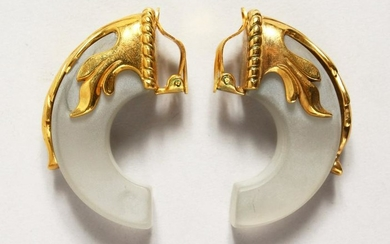 A PAIR OF CRYSTAL AND SILVER GILT EAR CLIPS shaped as