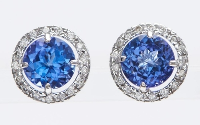 A PAIR OF TANZANITE AND DIAMOND EARRINGS-Each earring set with a round cut tanzanite weighing 3.60cts, surrounded by round brilliant...