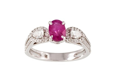 A RUBY AND DIAMOND THREE STONE RING, the oval ruby to pear s...