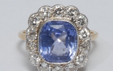 A diamond and natural colour change sapphire cluster ring, l...