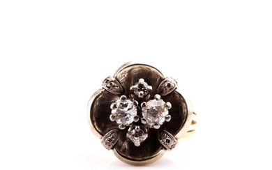 A diamond cluster ring, the white metal mount of quatrefoil ...