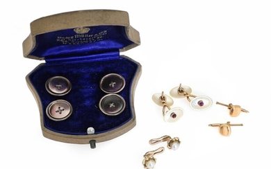 SOLD. A jewellery set comprising four buttons, a pair of cufflinks and two pair of...