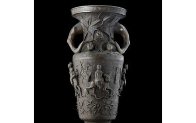 A large bronze vase decorated with relief figures, phytomorphic handles...