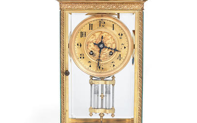 A late 19th / early 20th century gilt brass four glass clock