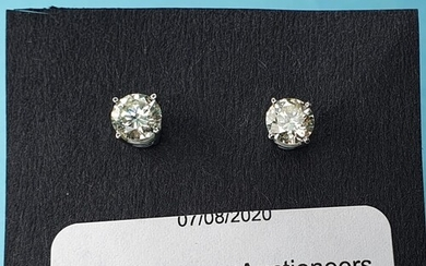 A pair of 18ct white gold screw back solitaire diamond studs...