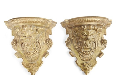 A pair of Renaissance Revival painted and giltwood wall...