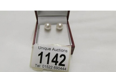 A pair of cultured pearl large stud earrings.
