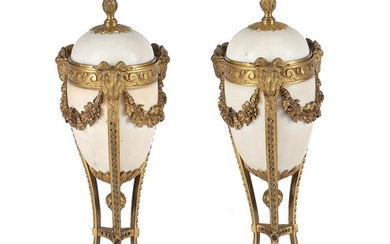 A pair of gilt-bronze and white marble mounted cassolettes in Louis XVI style
