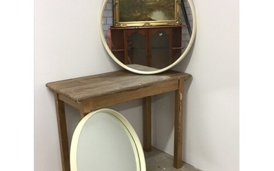 A pair of mid century round mirrors with early plastic frame...