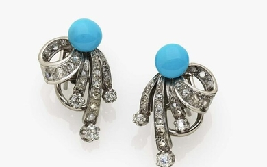 A pair of stud earrings with diamonds and turquoises