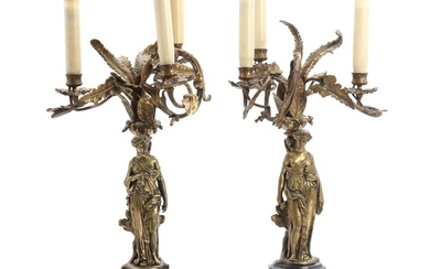 A pair of three-armed patinated bronze and black marble candelabras. Late 19th century. H. 59 cm. (2)
