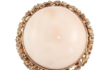 A pink coral bombe ring, the polished...