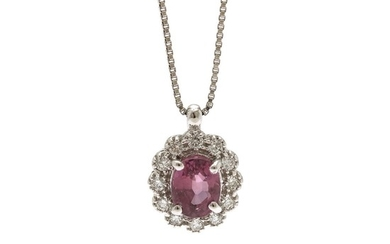 A ruby and diamond pendant set with an oval-cut ruby encircled by numerous brilliant-cut diamonds, mounted in 18k white gold and an 18k white gold necklace.