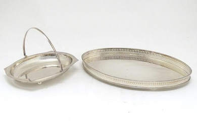 A silver plated oval tray with galleried side together