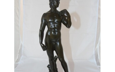 A well cast bronze figure of David on a marble base
