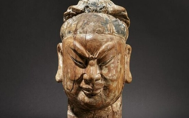 An imposing Chinese carved head of a high-ranking