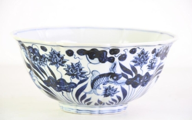 Blue and white Chinese lobed bowl decorated with fish among lotus plants, mark to base (Dia22.5cm H10.5cm)