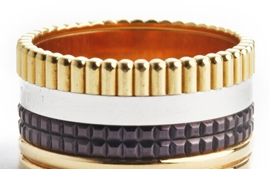 """Boucheron: A """"Quatre Classique Large"""" ring of 18k tri-coloured gold and brown PVD. Size 56. Ref. no. JGR00257–56. Serial no. N35128."""