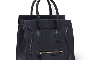 Celine - a navy blue leather Luggage tote bag.