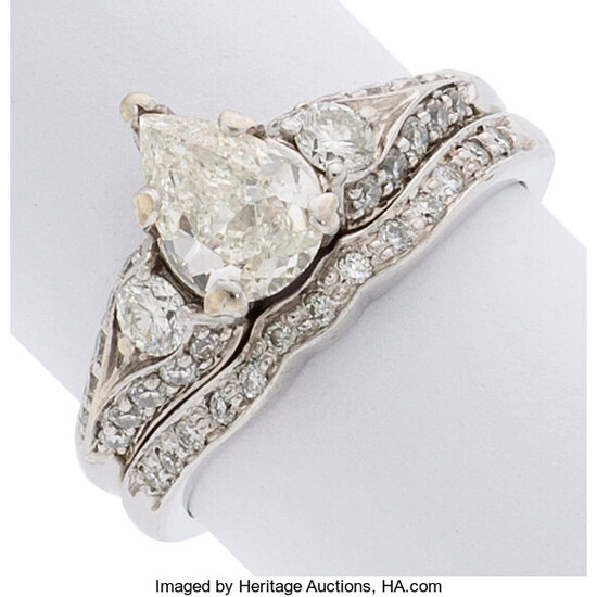 Diamond, White Gold Ring The ring features a pear-shaped...