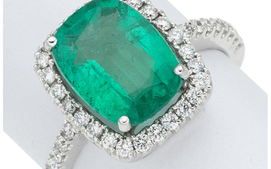 Emerald, Diamond, White Gold Ring The ring features a...