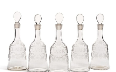 Five English engraved glass claret decanters, late 18th century