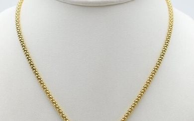 Necklace and charm in 18 ct yellow gold set with...