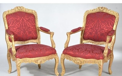 Pair of gilded wood frame with carved decoration of shells and garlands of foliage. Whiplash-shaped armrests. Curved legs topped with acanthus leaves ending in snail feet. Ep.XVIIIth century. H.102 L.70 P.54.