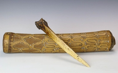 Papua, Asmat, carved bamboo horn and cassowary bone...