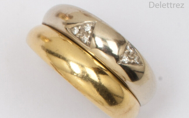 """Ring """" Double jonc """" in yellow and white gold, decorated with two triangular motifs set with brilliant-cut diamonds. Tour of doigt : 55. P. Brut : 8,8g."""