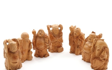 Seven Lucky Gods. Seven 20th centuy Japanese carved wood figurines. H. 12–12.5 cm. (7)