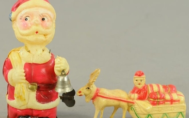 TWO CELLULOID SANTA CLAUS TOYS