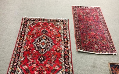 Two Small Rugs, including a sarouk, 5 ft. x 3 ft. 3 in. and 4 ft. 8 in. x 2 ft. 2 in.